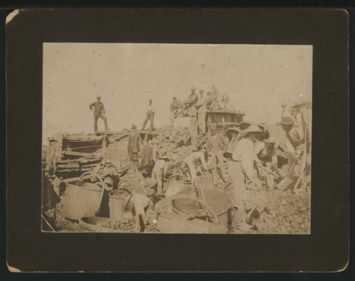 Clearing a train wreck, possibly in Seward County, Kansas - Page
