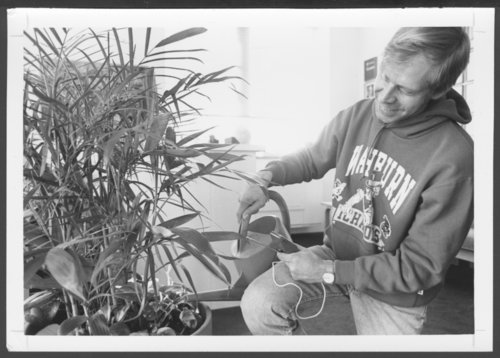 Checking moisture in a potted plant at the Menninger Foundation in Topeka, Kansas - Page
