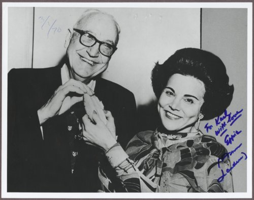 Karl Menninger, M.D. and Ann Landers sharing a cookie, Topeka, Kansas - Page