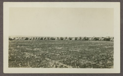 Row of cars parked at a corn husking contest near Goodland, Kansas - Page