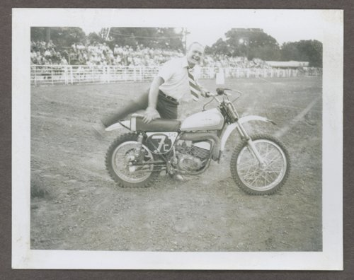 Vern Miller getting on a motorcycle in Wichita, Kansas