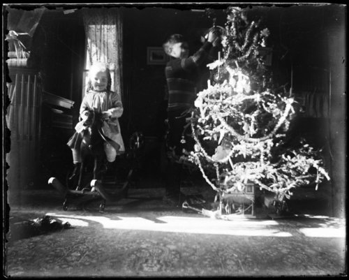 Children with a Christmas tree in Topeka, Kansas - Page