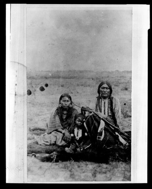 Chief Powder Face with wife and child, Hays, Kansas - Page