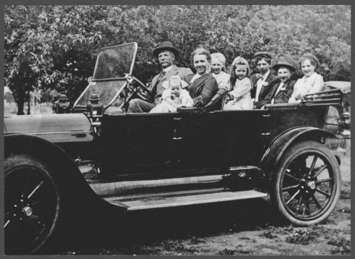 Hammer family seated in their car near Norway, Kansas - Page