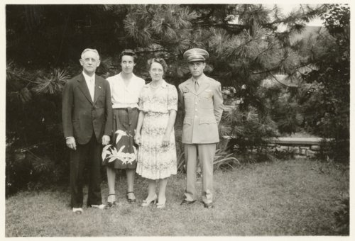 Robert S. Raymond with his parents and sister - Page
