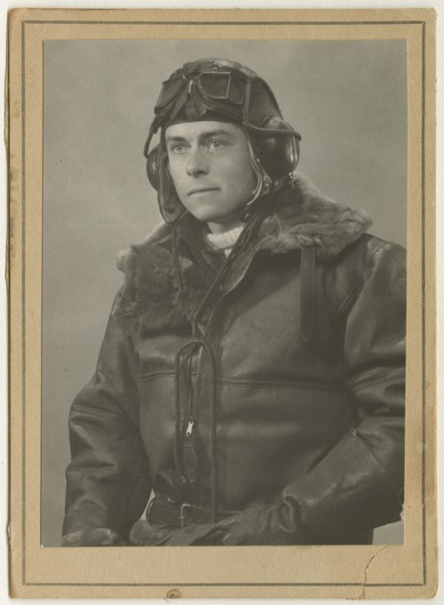 Robert S. Raymond dressed in his pilot's uniform - Page