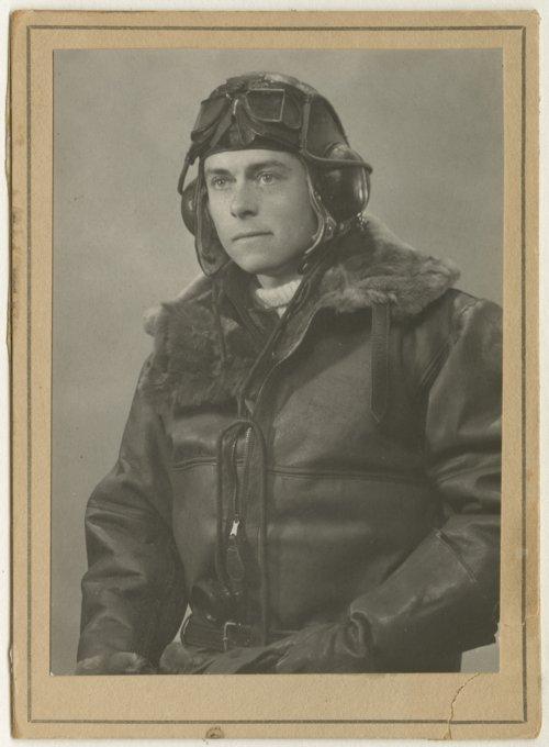 Robert S. Raymond dressed in his pilot's uniform - Page