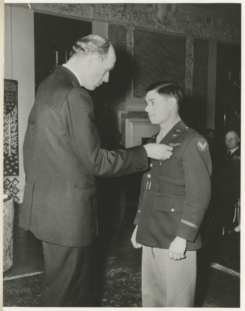 Robert S. Raymond receiving the British Distinguished Flying Cross - Page