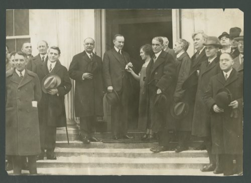 Vada Watson presenting President Calvin Coolidge with a bag of wheat - Page