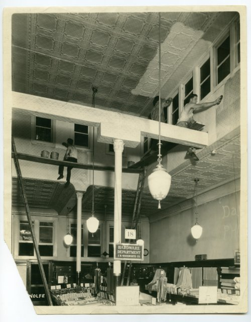 Cleaning or painting the interior of the F. W. Woolworth store in Topeka, Kansas - Page