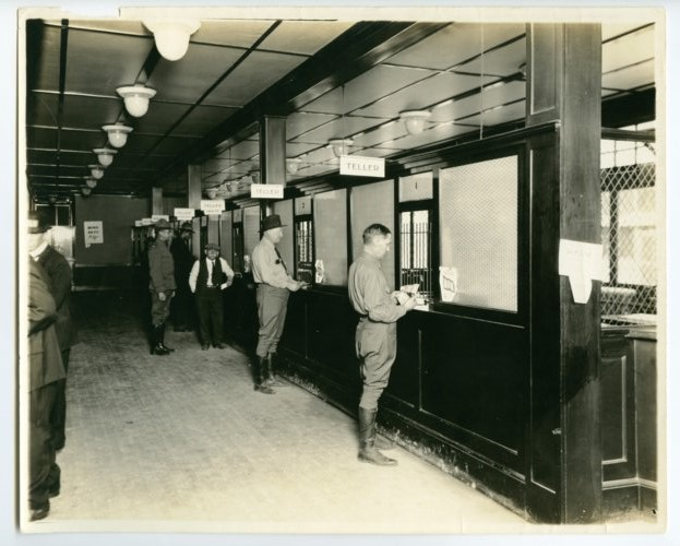 Customers at a bank in  Army City, Kansas - Page