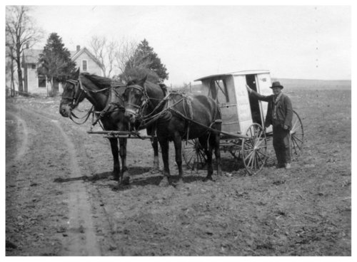 Isaac Hastings with mail carrier buggy in Alma, Kansas - Page