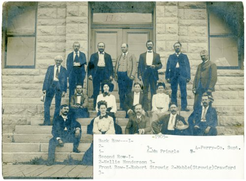Alma instructors on high school steps in Alma, Kansas - Page