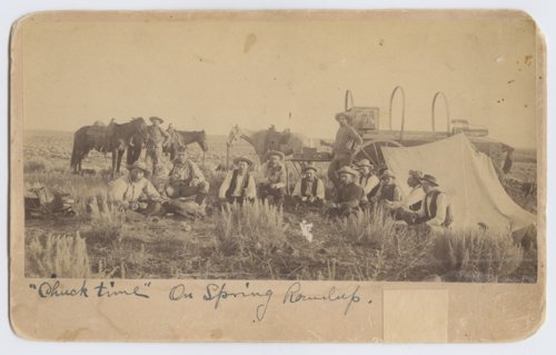 Cowboys sitting around a chuck wagon in Ford County, Kansas - Page
