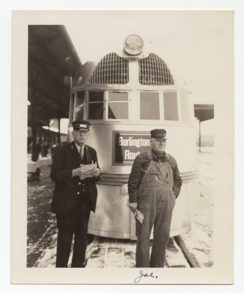 Joe Zinn standing in front of a Chicago, Burlington and Quincy Railroad locomotive - Page