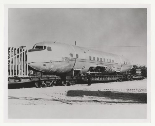 Airplane fuselage loaded on a Kansas City Southern Railroad flatcar - Page