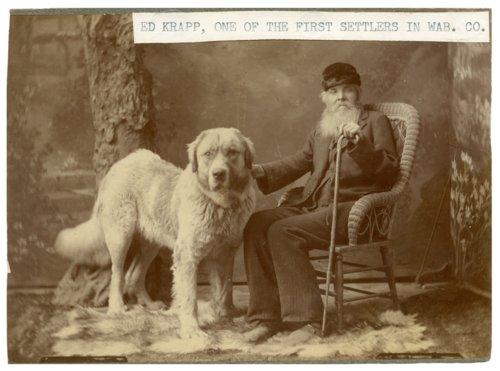Ed Krapp with pet dog in Alma, Kansas - Page