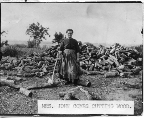 Mrs. John Combs cutting wood, Maple Hill, Kansas - Page