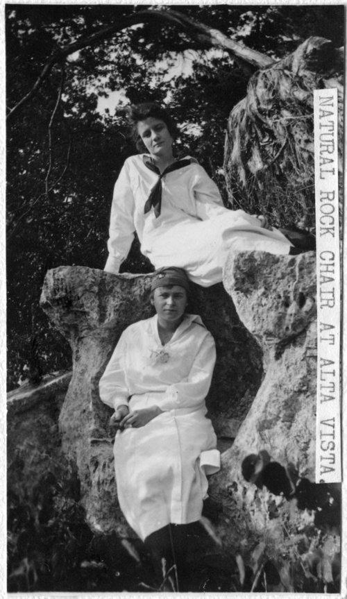 Unidentified women on natural rock chair, Alta Vista, Kansas - Page