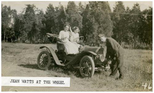 Jean Watts driving an automobile, Alma, Kansas - Page