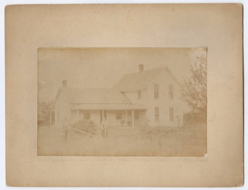 William and Mary (Blunderfield) Jolitz standing in front of their house near Talmage, Kansas - Page
