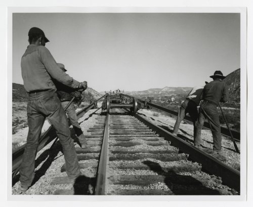Atchison, Topeka & Santa Fe Railway workers laying track - Page