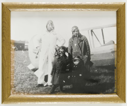 Howard Athon, Eunice Roberta Tournade, Merrill Dean Athon and Robert Eugene Athon posed with an Alexander Eaglerock bi-plane in Topeka, Kansas - Page