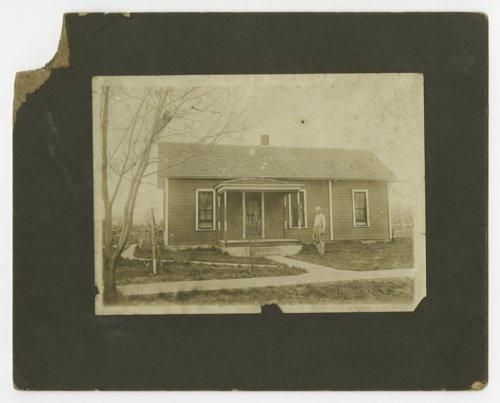 Aaron Lanning standing in front of his house near Melvern, Kansas - Page