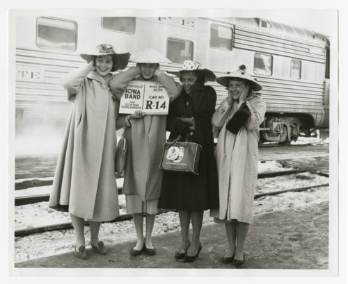 Women waiting to board an Atchison, Topeka & Santa Fe Railway passenger train - Page