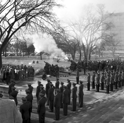 Firing cannons on the state capitol grounds for Governor George Docking's inauguration - Page