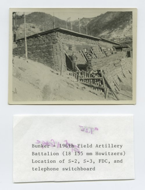 Frank Darrell Timken standing by a bunker in the Korean War - Page