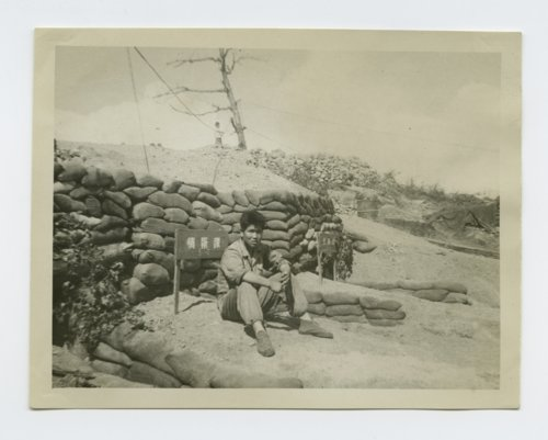 Republic of Korea soldier sitting on the back side of a front line bunker - Page
