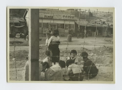 Children playing a game similar to jacks in Chuncheon, South Korea - Page