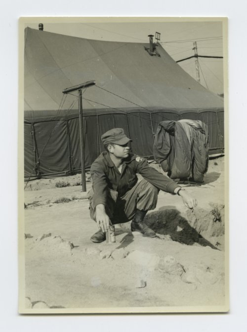 United States soldier relaxing with a drink in South Korea - Page