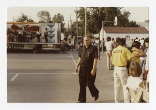 Father George Mationi walking around the Mexican Fiesta grounds in Topeka, Kansas - Page