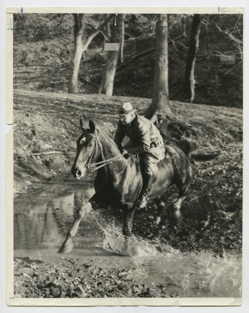 Governor Alfred Mossman Landon riding a horse - Page