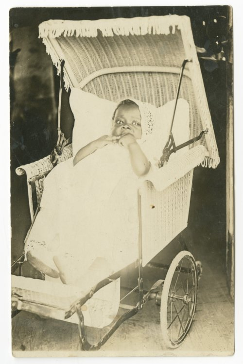 Baby in a wicker baby carriage - Page