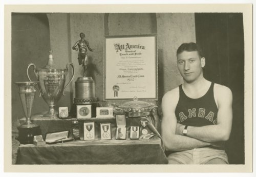 Glenn Cunningham with several trophies and medals - Page