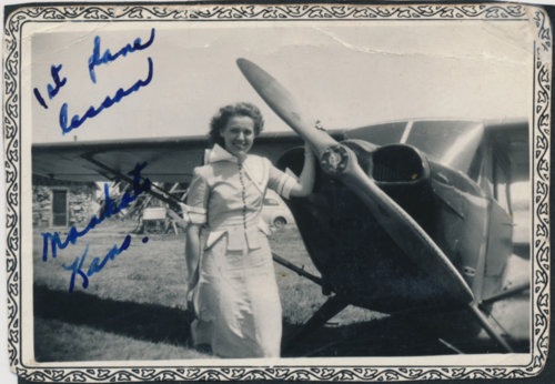 Elaine Hammer Walser with an airplane - Page