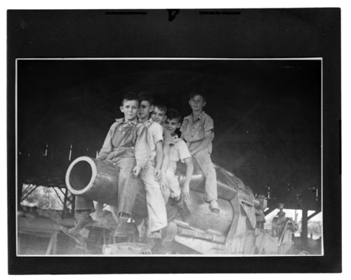 Children playing on a World War I memorial cannon in Columbus, Kansas - Page