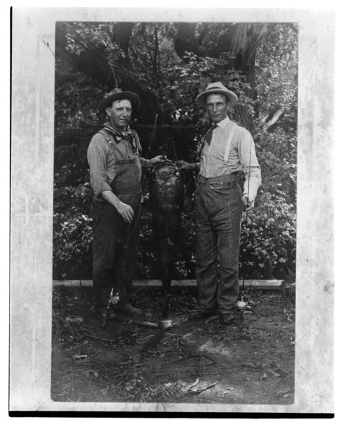Two fishermen with a large catfish in Clements, Kansas - Page