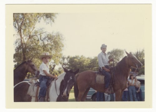 Robert Linder and Dwight Linder riding in a parade at Abilene, Kansas - Page
