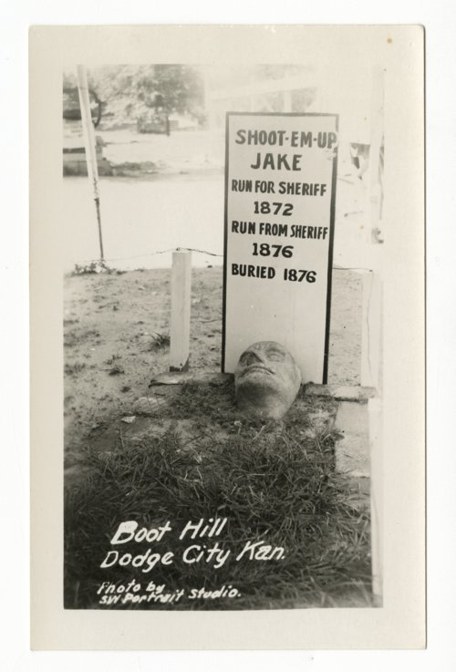 Headstone for Shoot-Em-Up Jake at Boot Hill in Dodge City, Kansas - Page