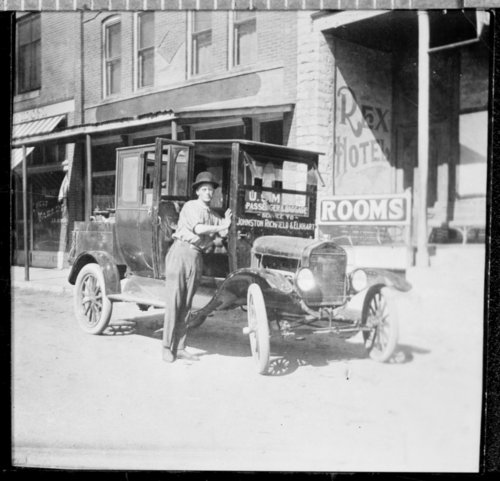 """F.J. Henderson stands with the model """"T"""" Ford he used to deliver the mail, Syracuse, Hamilton County, Kansas - Page"""
