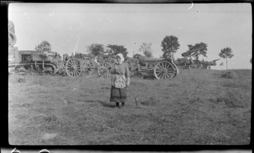 Nr. Kilberg, German woman turning hay, In front of U. S. tanks/cars - Page