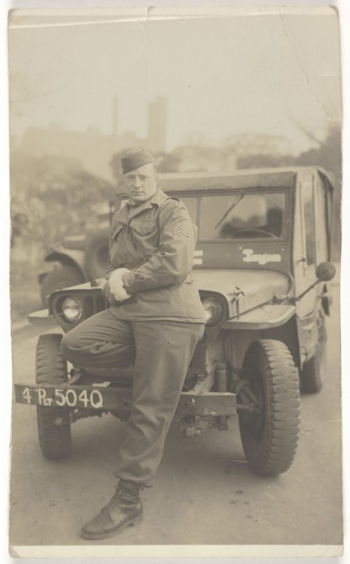Kenneth Harrison Hill in front of a jeep - Page