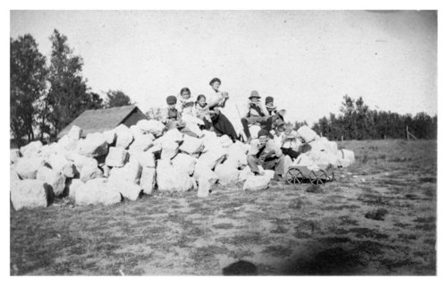 Children on a rock pile, Tom Pratt home, Sheridan County, Kansas - Page