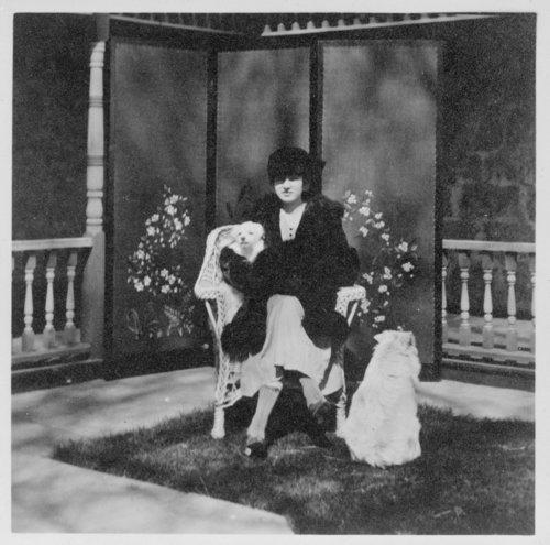 Unidentified woman sitting in front of the John Fenton Pratt home, Studley, Sheridan County, Kansas - Page
