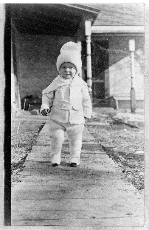 Child in a winter suit, John Fenton Pratt home, Studley, Sheridan County, Kansas - Page