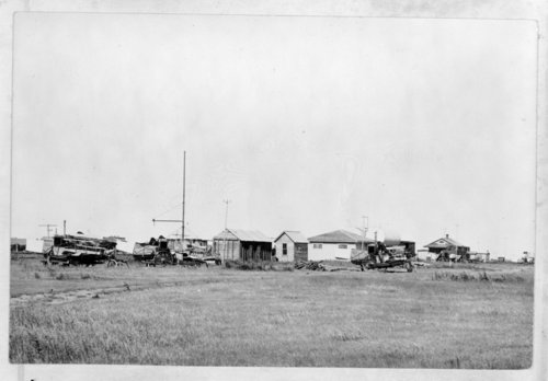 Farmhouse surrounded by harvest equipment, Tribune, Greeley County, Kansas - Page